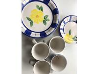 12 piece blue and yellow set of dinner plates side plates and mugs. Good strong set.