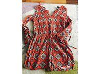 Orange patterned cold shoulder jumpsuit - size 10