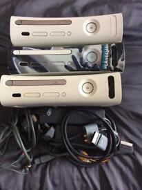 3 x Xbox 360 consoles and wires.