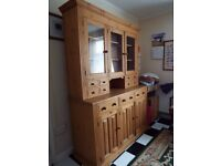 Pine dresser with glass doors and small drawers on upper part. £70