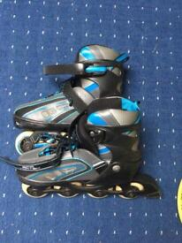 Roller blades-adjustable adult size 3-6