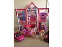 Barbie house, 2 barbie cars, wardrobe with barbie outfits & barbie horse & carriage