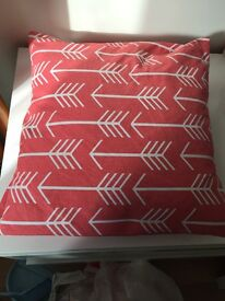 Two cushion covers - coral pink with white arrow pattern