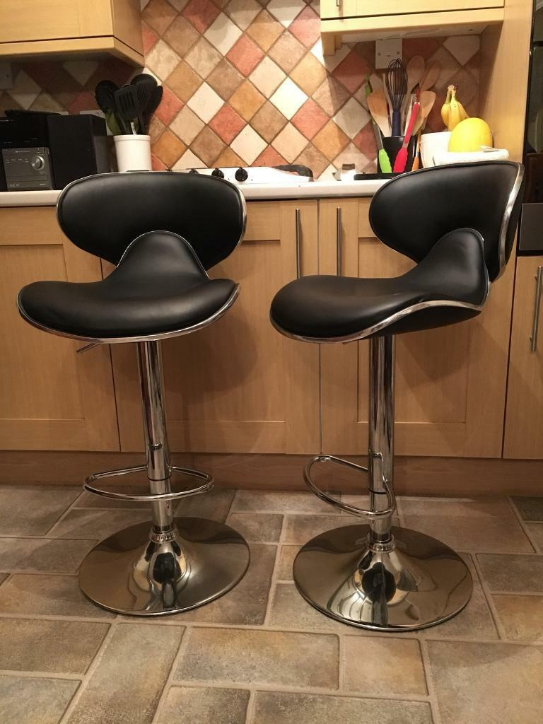 2 Black faux leather and chrome barstools.