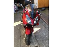 VFR VTEC IN CANDY RED. 57 Plate