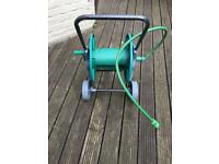 Hose pipe reel on wheels with fittings