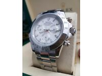 White faced Rolex Daytona with all silver casing & bracelet. Comes in a complete set with Rolex box