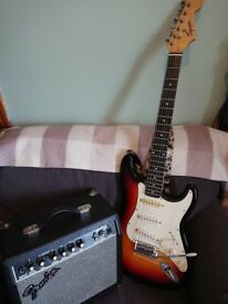 Fender Squire Stratocaster electic guitar and amp
