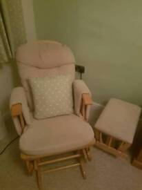 Rocking and gliding nursing chair and matching foot stool.