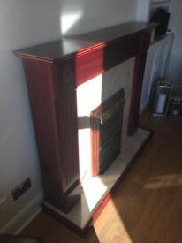 Freestanding Electric Fire with Wooden Fireplace Surround and Hearth
