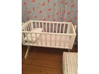 White rocking crib with bedding