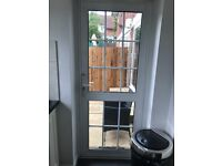 Variety of white doors and sliding patio doors