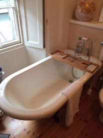 Free standing acrylic roll top bath with cast iron feet, hardly ever used, taps not included.