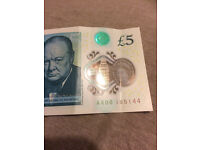 New £5 Polymer Note. Serial number: AA06 185144