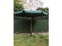 Large garden parasol umbrella with stand
