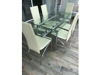 Glass table with six chairs