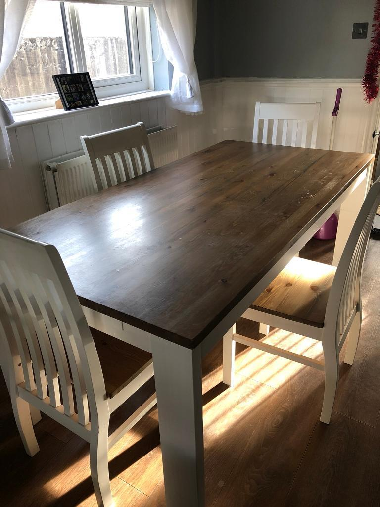 Big white and dark top Table and 4 chairs pick up from wollaton