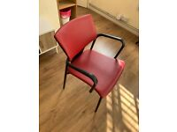 Red cushioned desk office chair with armrests
