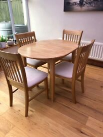 Light wood table and 4 chairs