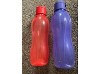 2 large Tupperware drinks water bottles purple and red
