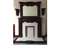 Attractive solid mahogany fireplace with tiled inset and hearth, matching mirror and fender