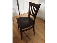 4 dark wood vintage chairs