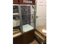 Fossil-branded free standing display cabinets