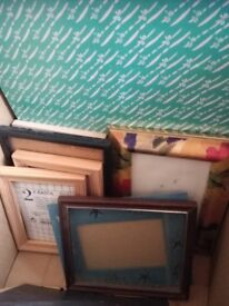 box of assorted picture frames and mounts