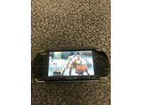 64gb black PSP slim console with 15,000 games