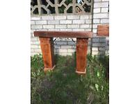 Small Sleeper garden bench with carved solid oak legs