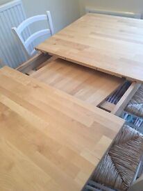 Large solid birch extendable dining table in great condition, seats 6 - 8 comfortably