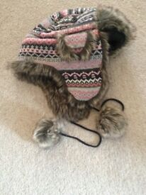 Trapper style Very WARM hat almost new. With fur lined ear muffs.