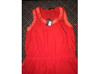 Tangerine/red jump suit size 12