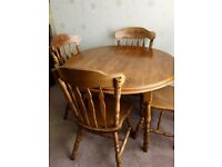 Extending dining table with 6 chairs, mid-oak colour, in excellent condition