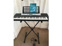 Yamaha portatone YPT-200 keyboard with adjustable stand, foot pedal and AC adaptor.