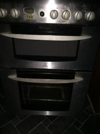 Silver indesit gas cooker.