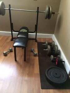 Bench press, leg extension machine and weights
