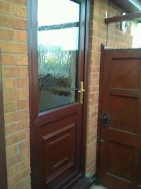 Upvc back door mahogany colour with 5 point security locks and obscure glass