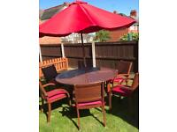 Patio table & 6 chairs parasol and seat covers