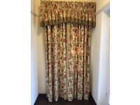 A pair of full length curtains