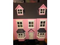 Large pink wooden dolls house and accessories