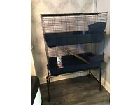 Large 2 tier guinea pig/rabbit cage with wooden ramp(as been chewed, hence the price) on casters.
