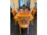 Antique pine extendable dining table and chairs