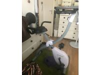 White Exercise bike. Removable laptop/magazine/cup holder