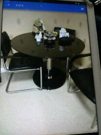 Black 3ft glass circular dining table + matching TV stand.