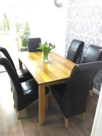Solid oak table with 6 leather chairs