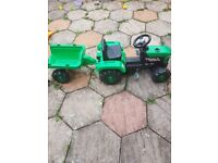 Green pedal tractor with detachable trailor for hours of fun for 2 year olds and older