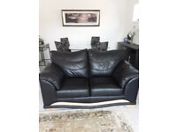 2no. Two seater leather settees