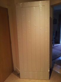 new internal door for sale. size 204/82.5. 6ft 9ins x 2ft 8ins.Still wrapped.
