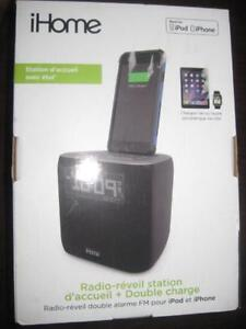 iHome Dual Alarm Clock. FM Radio. iPhone Lightning Dock with USB. AUX Audio in. Exceptional Sound Speaker. Charger. NEW